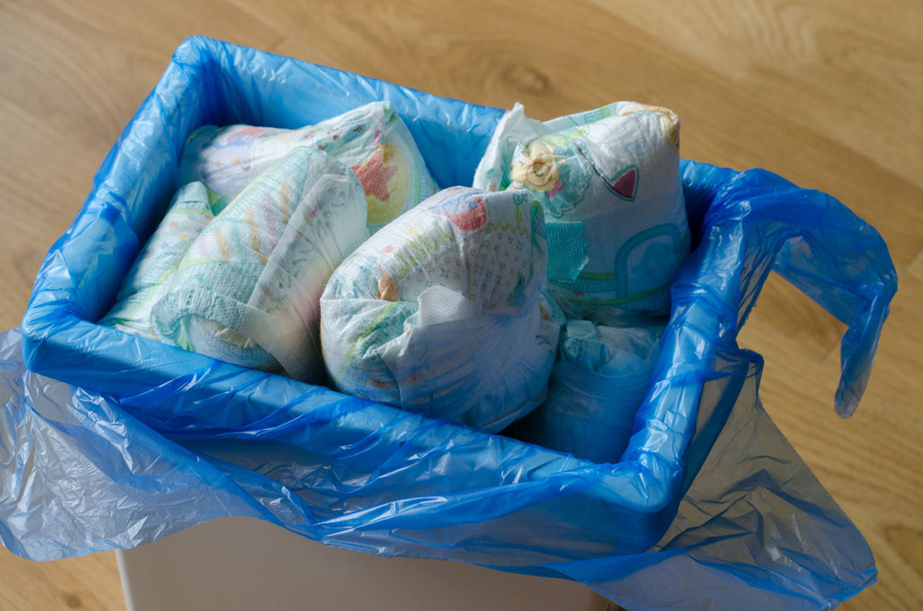 A lot of Disposable Diapers Thrown in the Trash